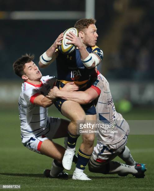 Worcester Warriors Luke Baldwin is tackled by Sale's Ben Curry and Kieran Wilkinson during the Anglo Welsh Cup match at Sixways Stadium Worcester