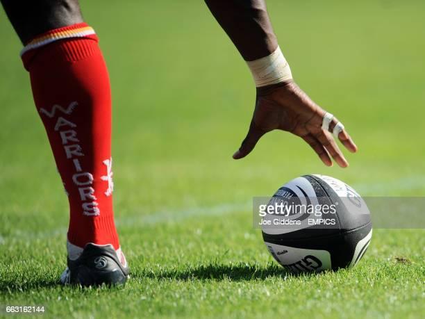 A Worcester Warriors player picks up a Guinness Premiership Matchball