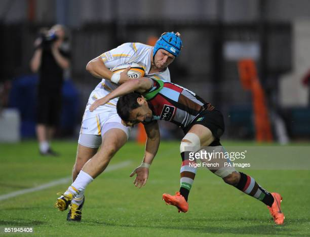 Worcester Warriors' Richard De Carpentier is tackled by Harlequins Jeremy Manning during the JP Morgan Prem Rugby 7's at the Recreation Ground Bath