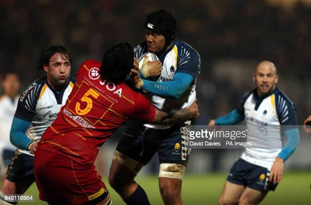 Worcester's Semisi Taulava hands off Romain Taofifenua of Perpignan during the Amlin Challenge Cup Pool Two match at Sixways Stadium Worcester