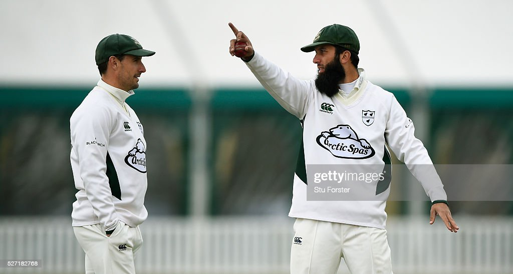 Worcestershire bowler <a gi-track='captionPersonalityLinkClicked' href=/galleries/search?phrase=Moeen+Ali&family=editorial&specificpeople=571813 ng-click='$event.stopPropagation()'>Moeen Ali</a> (r) discusses field placings with captain <a gi-track='captionPersonalityLinkClicked' href=/galleries/search?phrase=Daryl+Mitchell+-+Cricketer&family=editorial&specificpeople=4695780 ng-click='$event.stopPropagation()'>Daryl Mitchell</a> during day two of the Specsavers County Championship Division Two match between Worcestershire and Essex at New Road on May 2, 2016 in Worcester, England.