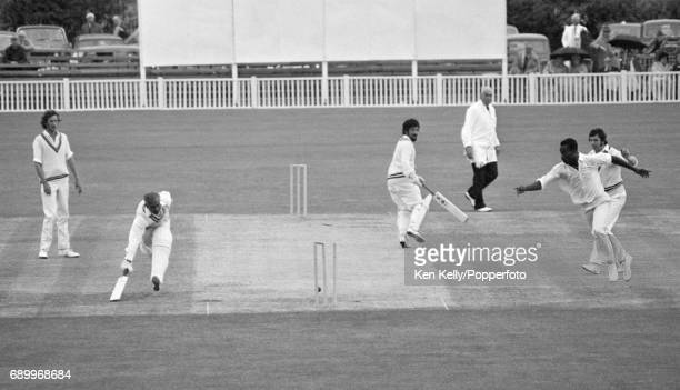 Worcestershire bowler Vanburn Holder attempts to run out Warwickshire batsman Rohan Kanhai during the Benson and Hedges Cup group match between...