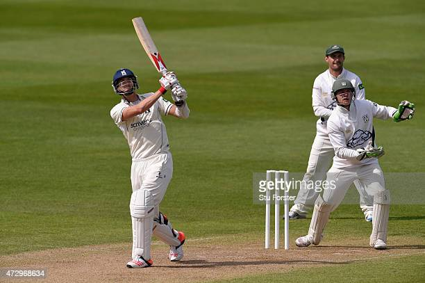 Worcestershire keeper Ben Cox looks on as Chris Wright hits a six during day three of the LV County Championship Divison One match between...