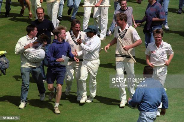 Worcestershire players Ian Botham Damian O'Oliveira Tom Moody and Tim Curtis leaving the field after winning the Benson Hedges Cup at Lord's
