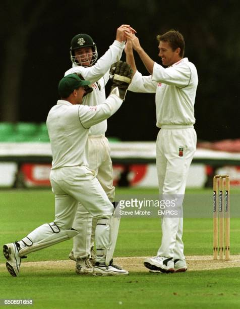 Worcestershire's Glenn McGrath celebrates taking the wicket of Gloucestershire's Robert Cunliffe LBW during the first over