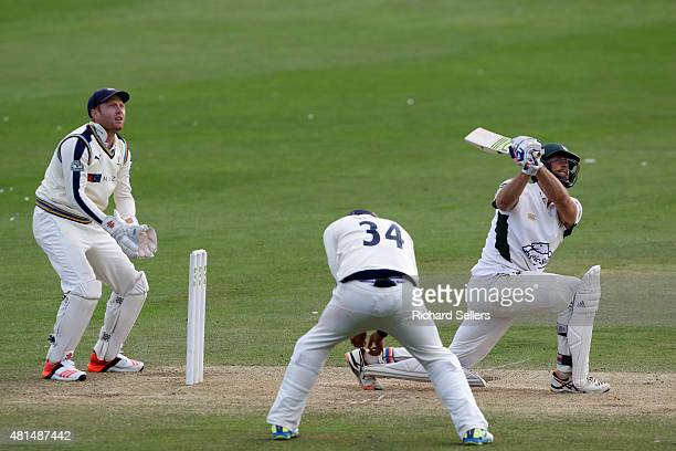 Worcestershire's Ross Whiteley hits a six as Yorkshire's Jonny Bairstow left looks on during day three of the LV County Championship division one...