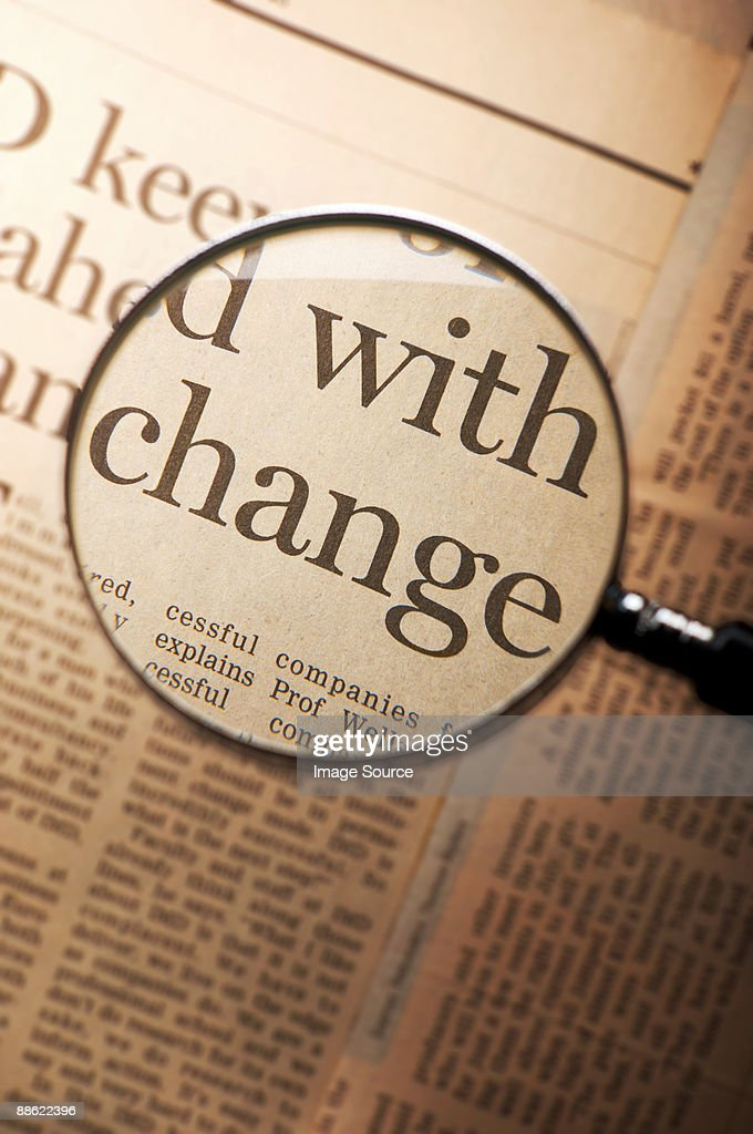 Word change under magnifying glass : Stock Photo