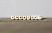 Word CONFLICT made with wood building blocks,stock image