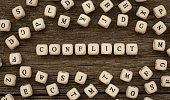 Word CONFLICT written on wood block,stock image