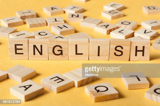 Word english made with block wood letters next to a : Stock Photo