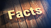 The word 'Facts' is lined with gold letters on wooden planks. 3D illustration graphics