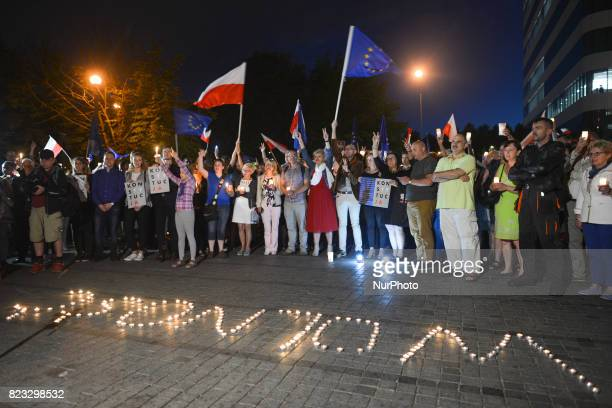 A word 'Freedom' made from candles during an antigovernment candlelit vigil in front of Krakow's District Court on Wednesday evening where hundreds...