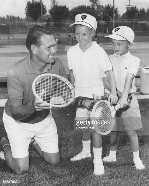 Word from the Wise Jack Kramer former amateur and professional tennis great poses with Mark McClintock and John Gulick at Cherry Hills Country Club...