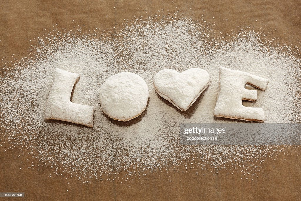 Word 'Love' made by biscuits and icing sugar