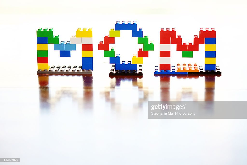 Word 'Mom' built with multi- colored blocks : Stock Photo