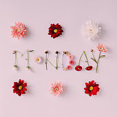 """Word """"MONDAY"""" made of flowers on bright background. Spring concept. Flat lay"""