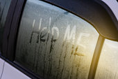 word of help me write on car's mirror, full of raindrop