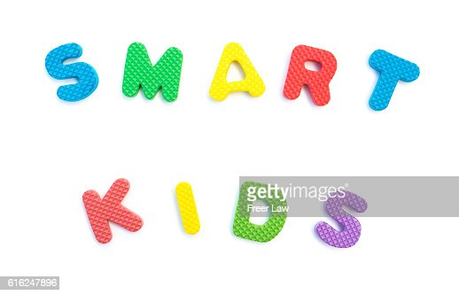 word of smart kids shaped by alphabet puzzles on white : Foto de stock