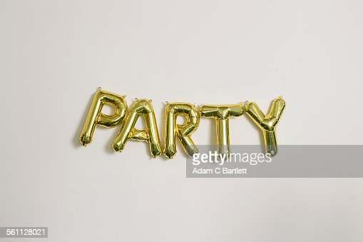 Word party in gold inflatable capital letters