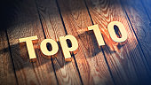 The word 'Top 10' is lined with gold letters on wooden planks. 3D illustration image
