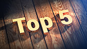 Short list of best of bestest. The word 'Top 5' is lined with gold letters on wooden planks. 3D illustration image