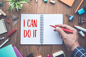 I CAN DO IT word writing on notepad and office supplies.business motivation concepts ideas