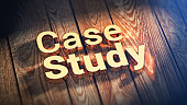"""The words """"Case Study"""" is lined with gold letters on wooden planks. 3D illustration image"""