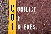 CONFLICT OF INTEREST , words concept on Asphalt with Yellow Dividing Line.