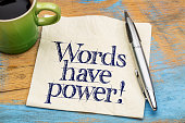 Words have power - handwriting on a napkin with cup of coffee