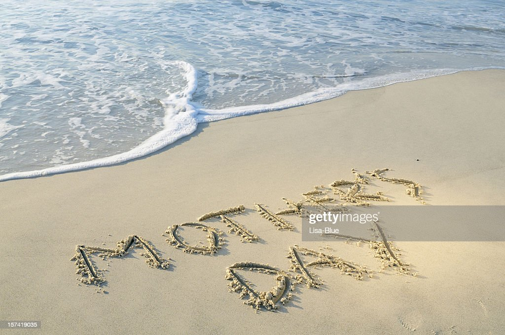 Words Mothers Day Written in the Sand With Wave