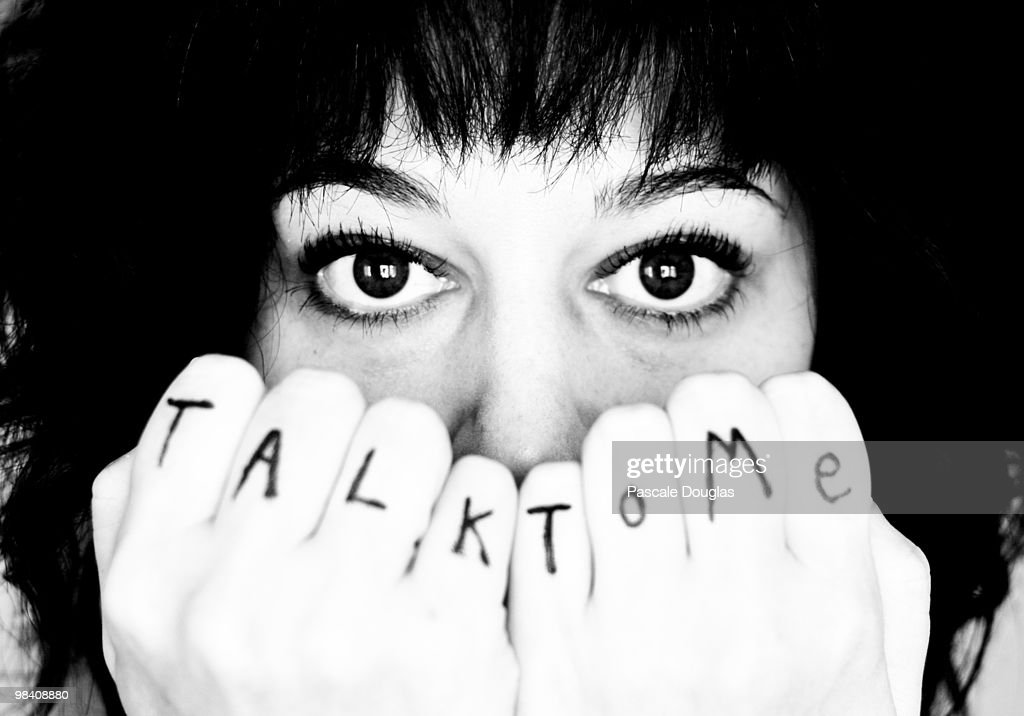 Words on Clentched Fists in Front of Woman's Face : Stock Photo
