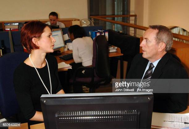 Work and Pensions Secretary John Hutton talks to Florence Dettwiler about the benefits of saving for a pension during a visit to a company in...