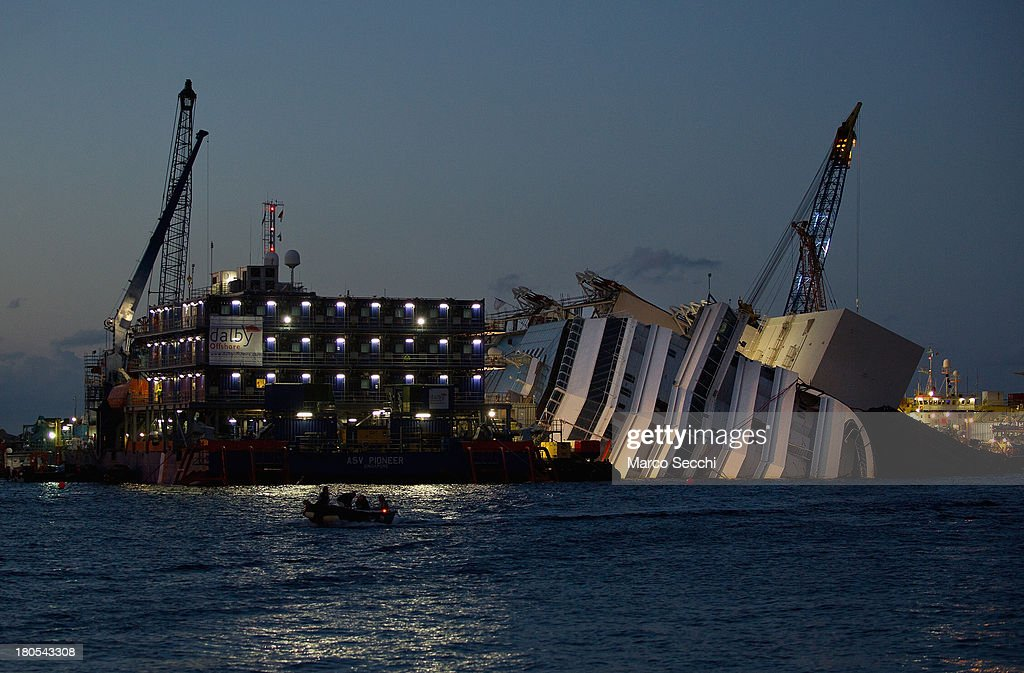 Work at the wreckage of the Costa Concordia continues through the night September 14, 2013 in Isola del Giglio, Italy. The Costa Concordia is reportedly due to be righted beginning on the morning of September 16th when it will then be towed away and scrapped.