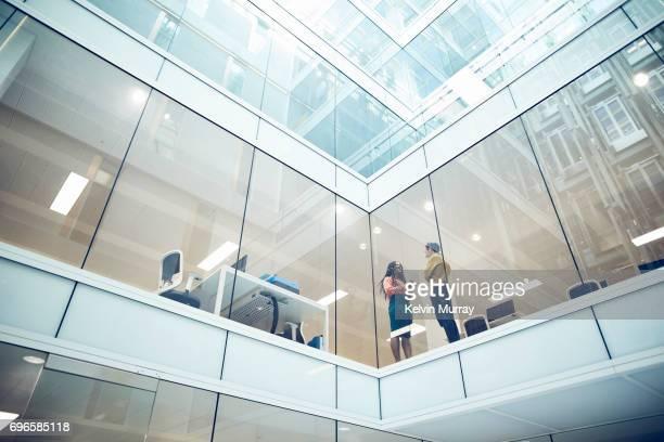 Work colleagues talking in modern office