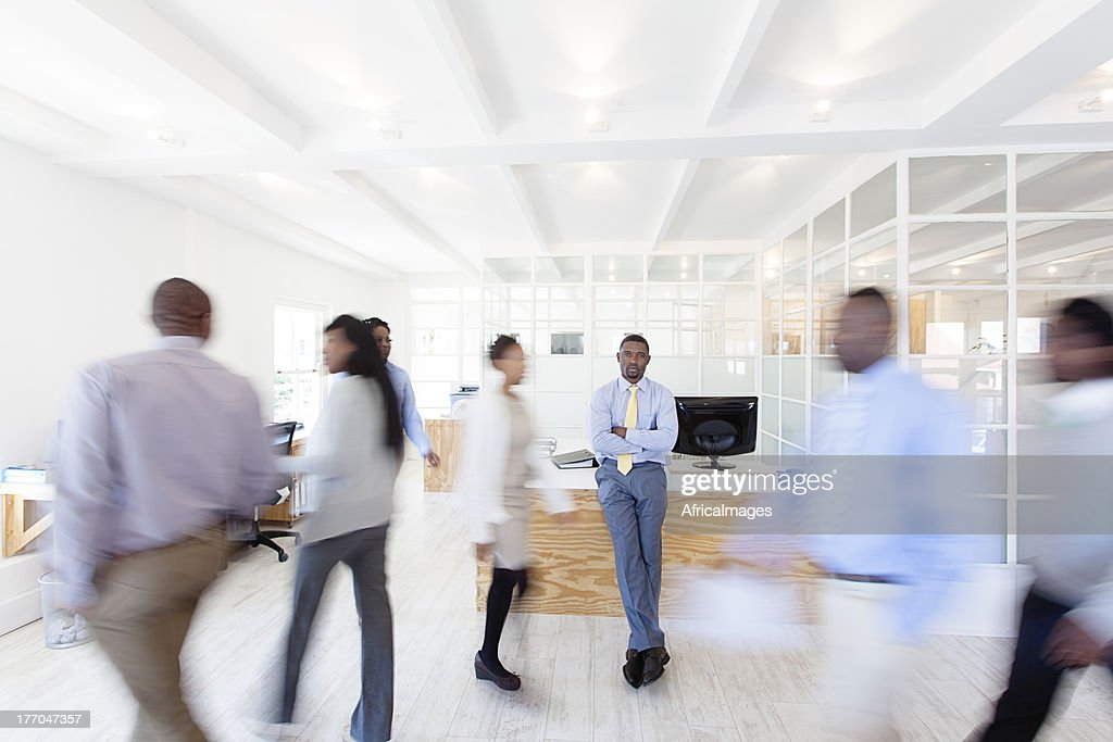 Work Colleagues walking around their office, Africa
