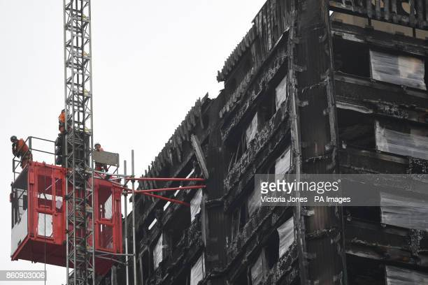 Work commences to cover the ruin of Grenfell Tower nearly four months since a fire inflicted the most costly tragedy in recent British history