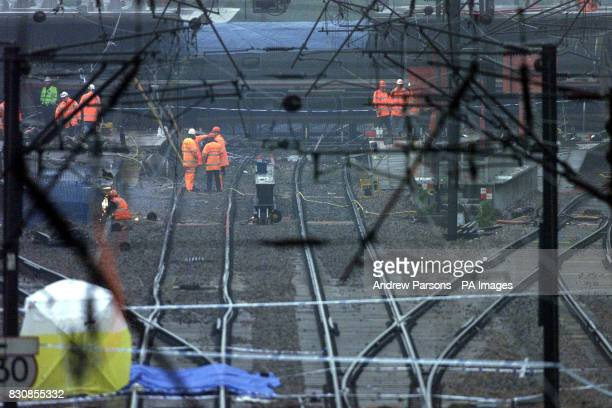 Work continues at Potters Bar station north of London where engineers are hoping to remove the fourth carriage of the train which is wedged under the...