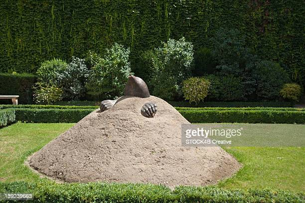 Work of art with mole emerging from molehill, Hotel de Sully, Marais, Paris, France