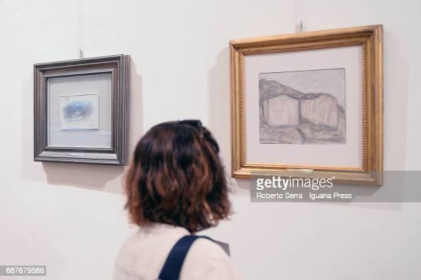Work 'Paysege' of Jean Fautrier and 'Paesaggio di Grizzana' of Giorgio Morandi insert in the exhibition of the new Quadreria at Palazzo Magnani on...