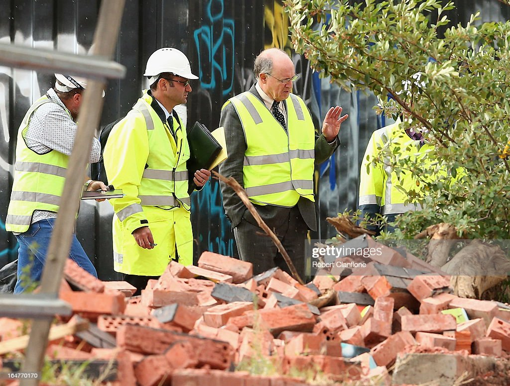 Work Safe investigators are seen at the scene of a wall collapse on March 28, 2013 in Melbourne, Australia. Police have confirmed three people have died after a brick wall collapsed on Swanston street in Carlton in North Melbourne CBD.