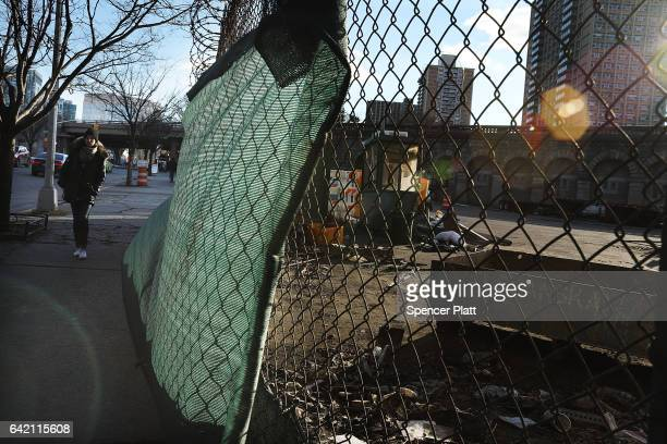 A work site stands next to the Brooklyn Bridge on February 16 2017 in New York City An annual report by the American Road and Transportation Builders...