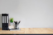 Work space Mock up white tabletop with files, pencils and houseplant. wood desk with copy space for products display montage.
