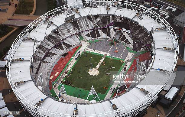Work starts to clear the Olympic Stadium at Stratford the day after the London 2012 Paralympic Games closing ceremony on September 10 2012 in London...