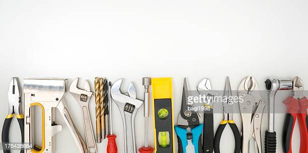 Work tools lined up on a white background