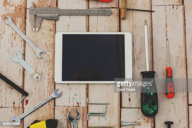 Work tools of a craftsman and  digital tablet.Top view