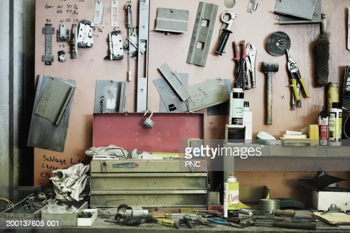 Workbench cluttered with tools