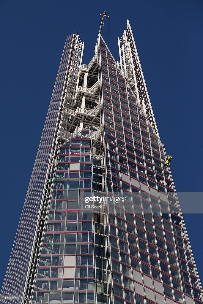 A worker abseils down the outside of the Shard skyscraper on February 8, 2013 in London, England. The Shard, at 310m is the tallest building in Western Europe and has recently opened a public viewing deck on the 68th, 69th and 72nd floors.