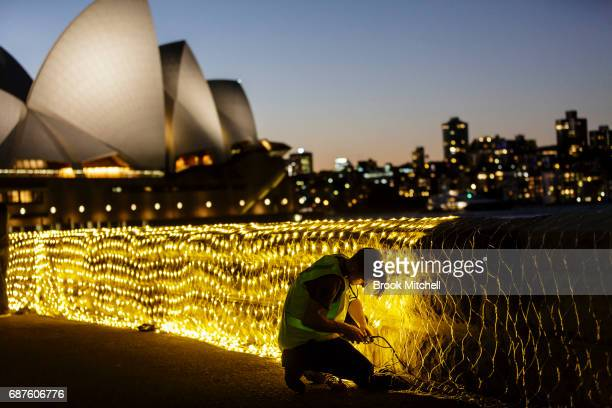 A worker adds final touches to the Sunflowers light installation ahead of Vivid Sydney at The Royal Botanic Gardens on May 24 2017 in Sydney...