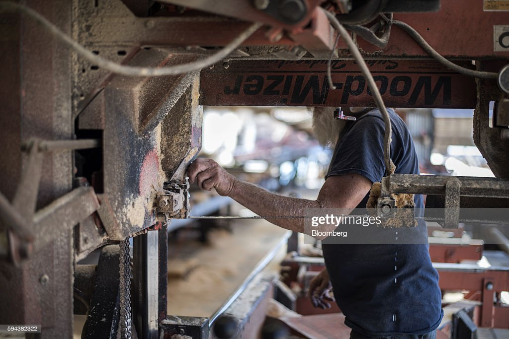 A worker adjusts a saw blade at the Spotted Owl Timber Inc mill in Santa Fe New Mexico US on Monday Aug 15 2016 Founded in 1991 the family owned and...