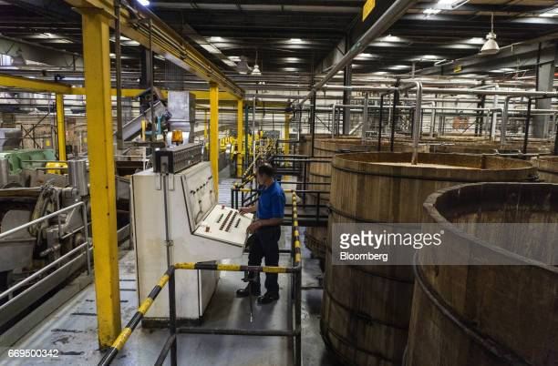 A worker adjusts controls in front of fermentation tanks at the Patron Spirits Co distillery in Atotonilco El Alto Jalisco Mexico on Tuesday April 4...